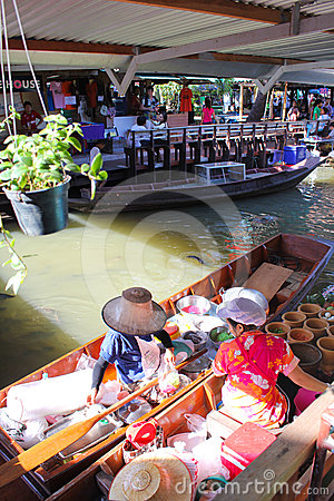 Wooden boats busy ferrying people at Talingchan fl Editorial Image