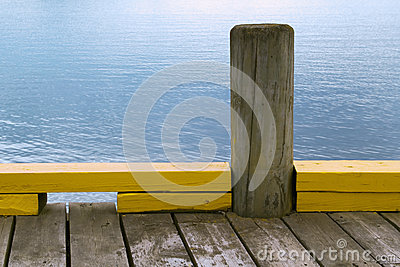 Wooden bollard on the dock