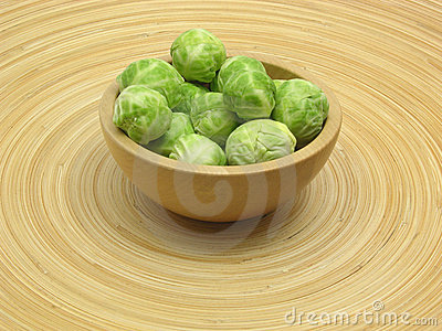 Wooden bowl with brussels sprouts