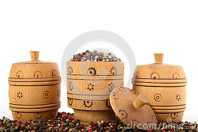 Wooden bowl full of mixed peppers