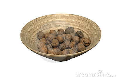 Wooden bowl with walnuts