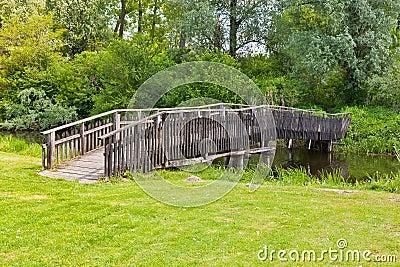 Wooden bridge across the pond
