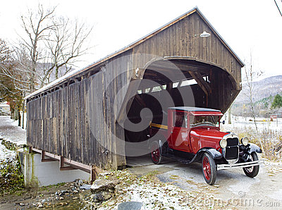 Wooden bridge with old car