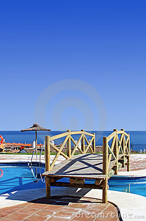 Wooden bridge over swimming pool in Spanish urbanisation