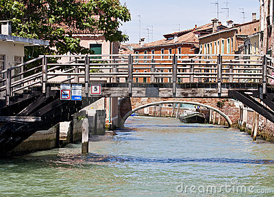Wooden Bridge Over Venice Canal