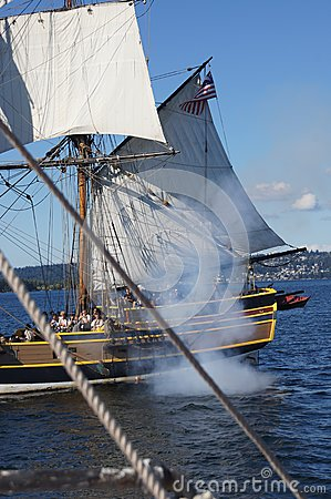 The wooden brig, Lady Washington, fires her cannon Editorial Image
