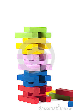 Wooden building blocks, in many colors, isolated on white