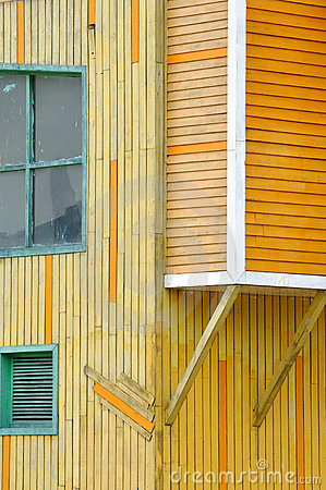 Wooden building in yellow and orange