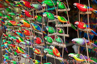 Wooden carved parrots