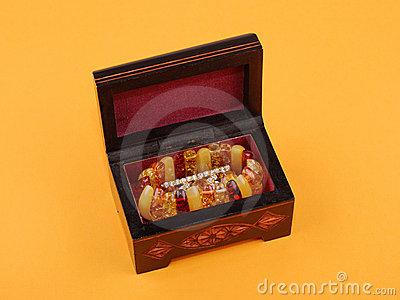 Wooden casket with jewelry