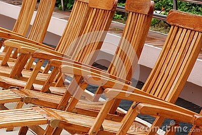 Wooden chair at the pool side