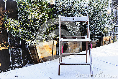 Wooden Chair on Snowy Porch