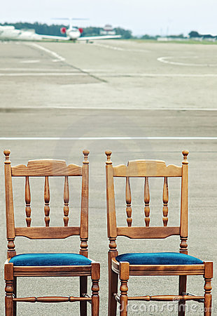 Wooden chairs on airfield