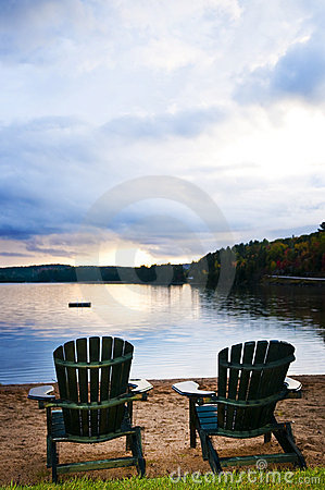 Free Wooden Chairs At Sunset On Beach Stock Image - 12568971