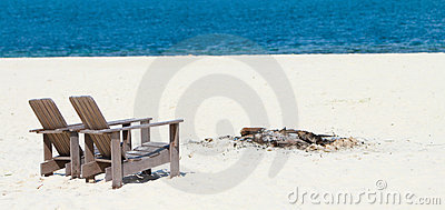 Wooden chairs at tropical beach panorama