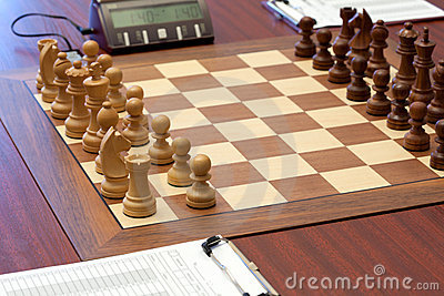 Wooden chess is placed on chessboard