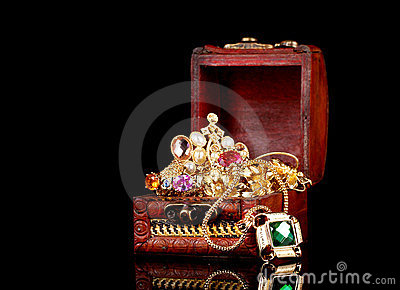 Wooden chest full of gold jewelry