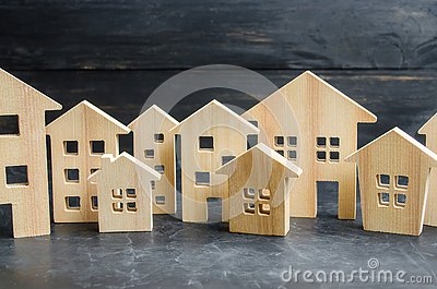 Wooden city and houses. concept of rising prices for housing or rent. Growing demand for housing and real estate. Stock Photo