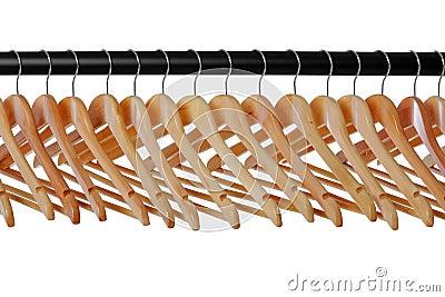 Wooden coat hangers on rail