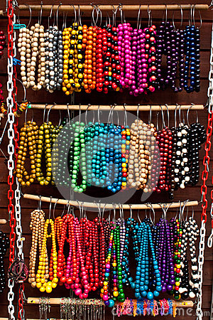 Wooden colored beads on display on the market