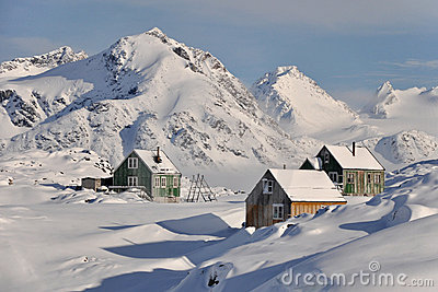 Wooden colourful cottages in winter