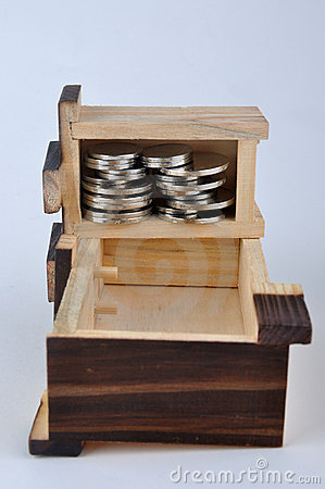Wooden container and coin