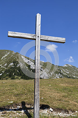 Wooden cross in the Alps