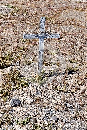Wooden cross on desert grave