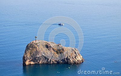 Wooden Cross On Rock