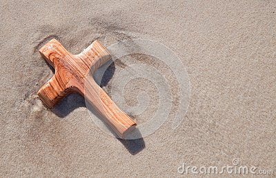 Wooden cross in sand - card for mourning
