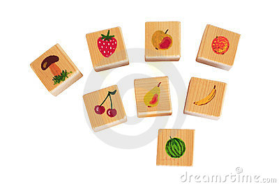 Wooden cubes with fruits
