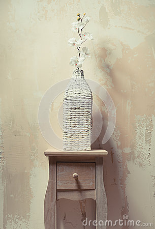Wooden cupboard with white orchid
