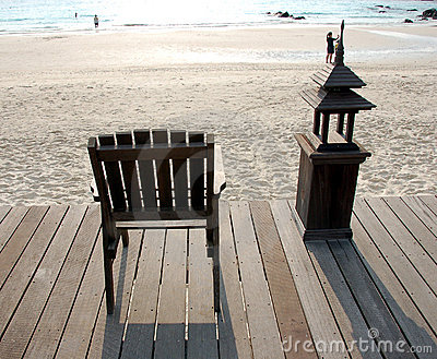 Wooden Deck Chair Facing Sea