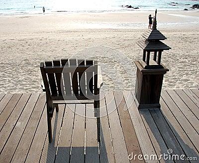 Wooden Deck Chair Facing Sea
