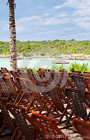 Wooden Deck Chairs in Caribbean Beach