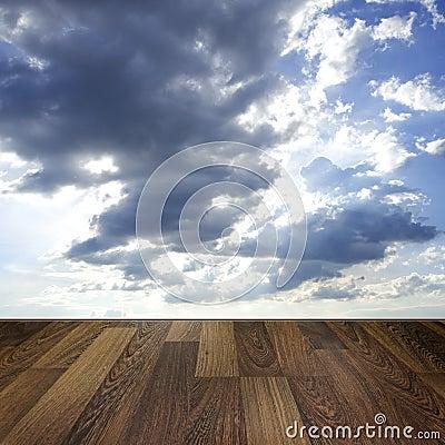 Wooden deck floor over blue sky background