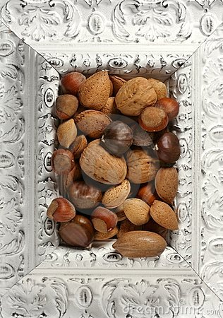 Wooden decorated classic white frame, varied nuts