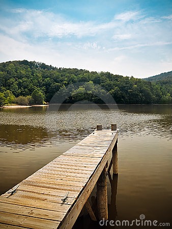 Wooden Dock Overlooking Peaceful Mountain Lake
