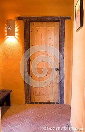 Wooden door in an adobe home
