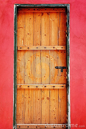 Free Wooden Door As Red Wall Stock Photos - 16111283