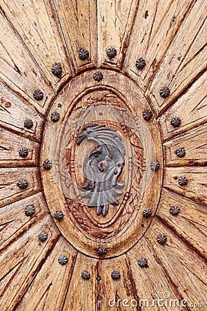 Wooden door with emblem
