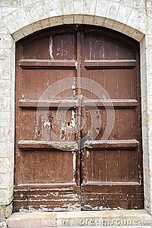 The wooden door on the old walls