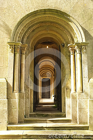 Wooden Door way through stone arches