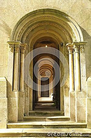 Wooden Door way through stone arches