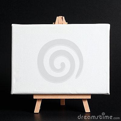 Wooden easel on a dark background.