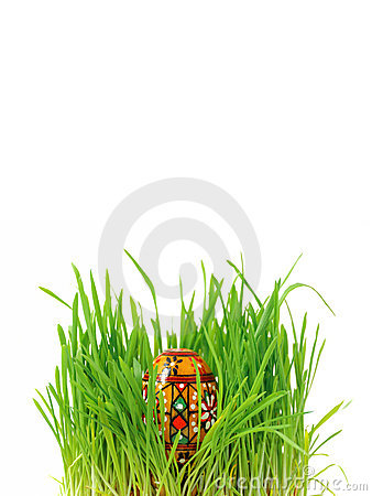 Wooden Easter egg in the grass