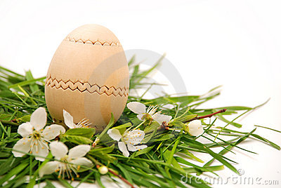 Wooden easter egg in a spring nest