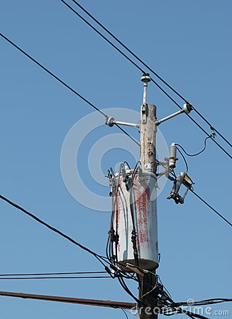 Wooden electrical pole isolated.
