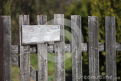 Wooden fence with empty sign board