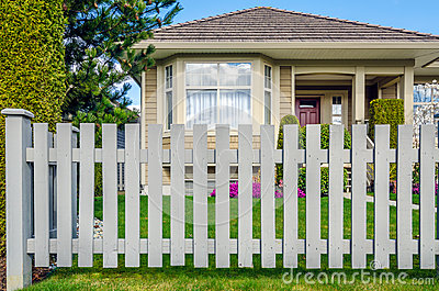 Wooden fence and house in background stock photo image - House behind a house designs ...